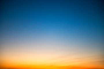 Sunset in the sky with blue, orange and red dramatic colors