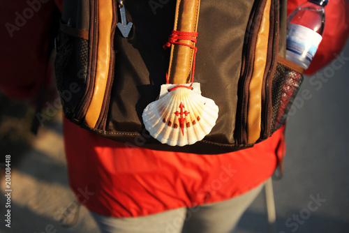 Photo Scallop in the backpack, pilgrim on the road to Santiago (Camino de Santiago),