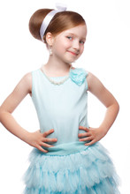 A Little Girl In A Blue Dress, With A Retro Hairstyle And Accessories. Photo Taken In Studio