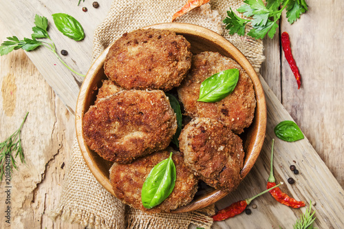 Fotografia Homemade pork-beef cutlets or meatballs in a bowl, rustic style, vintage wooden