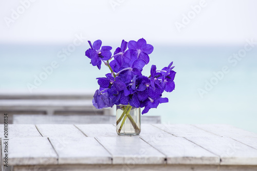 Fotobehang Orchidee Beautiful bouquet of blue orchids flower on a white wooden table near sea. Thailand