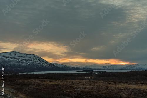 Spoed Foto op Canvas Grijze traf. The frozen Torneträsk Lake in the Abisko National Park at sunset / Lapland, Sweden