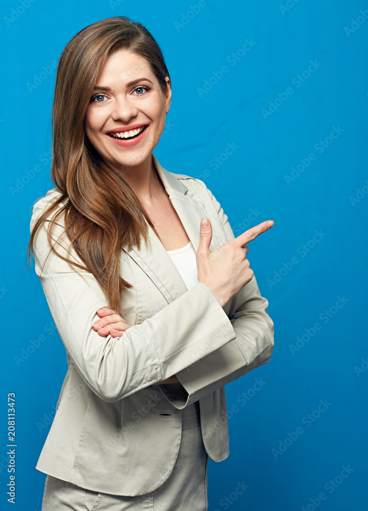 Fototapety, obrazy: Woman wearing business suit pointing up with finger.
