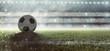 canvas print picture Fußball liegt auf Stadionrasen im Rauch