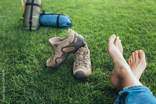 Fotografie, Obraz Selfie bare feet on green grass after a long hike