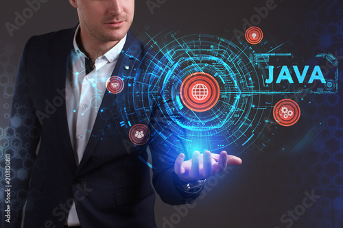 Fototapeta Business, Technology, Internet and network concept. Young businessman working on a virtual screen of the future and sees the inscription: Java obraz