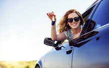 An Attractive Woman In A Car H...