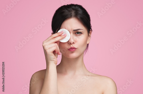 Fototapeta  Young girl with cleaning cotton pad