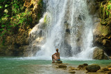 Tourist swimming in the Salto el Limon the waterfall located in the centre of the tropical forest, Samana, Dominikana Republic.