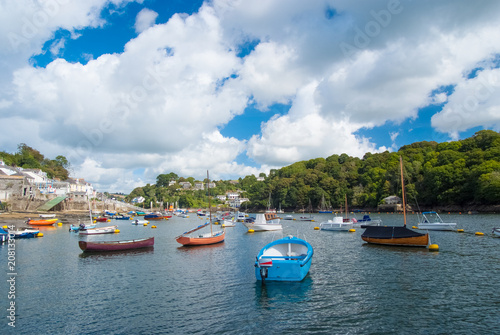 Fowey, United Kingdom - March 24, 2010: boats in sea harbor on cloudy sky. Speed and sailing boats on water. Summer vacation in sea. Travelling by water. Wanderlust and adventure