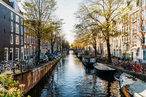 Foto op Canvas Amsterdam Beautiful Architecture Of Dutch Houses and Houseboats On Amsterdam Canal In Autumn