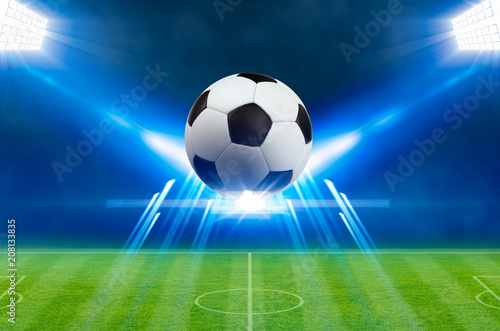soccer-ball-bright-spotlights-illuminates-green-soccer-stadium