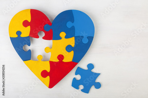 Photo A colorful heart made of symbolic autism puzzle pieces.