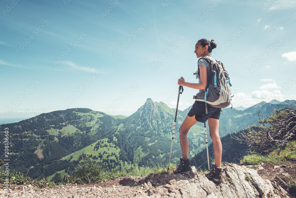 Fototapety, obrazy: Healthy fit young woman hiker on a mountain summit