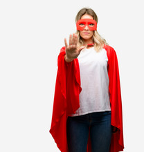 Young Super Hero Woman Wearing Cape Annoyed With Bad Attitude Making Stop Sign With Hand, Saying No, Expressing Security, Defense Or Restriction, Maybe Pushing