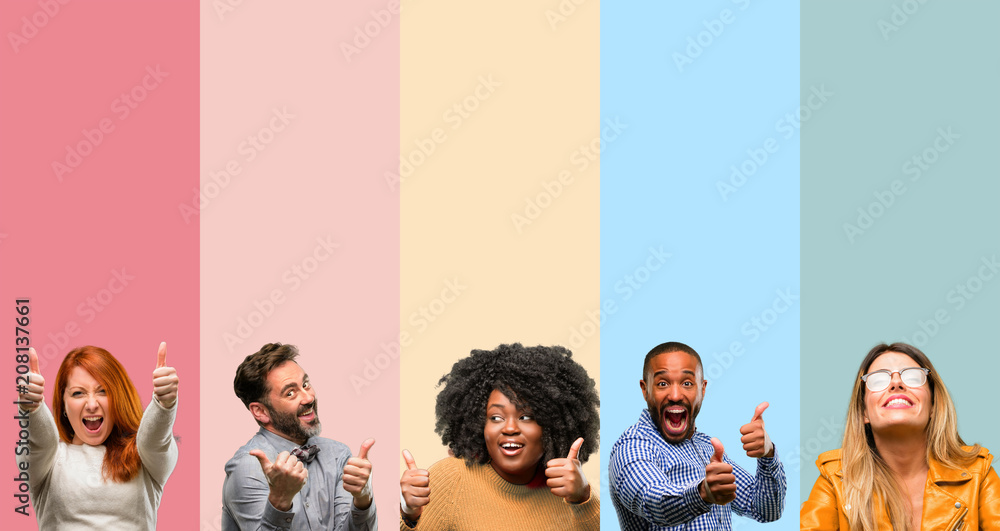 Fototapeta Cool group of people, woman and man stand happy and positive with thumbs up approving with a big smile expressing okay gesture