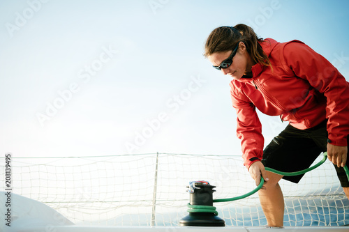 Fotografía  Attractive strong woman sailing with her boat