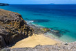 Secluded beach in the Papagayo Coast in Lanzarote, Spain
