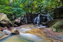 Long Exposure Of A Tropical Waterfall In Middle Of A Rain Forest With Water Pond Beneath It, Koh Phangan, Thailand