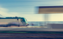 Blurred Image Of Train Passing Through Station.