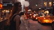 Young beautiful woman standing near the traffic road close to smoke pipe in New York, America and waits for taxi.