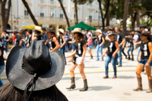 Black Hat On Flash Mob Backgroung In City Street