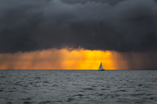 Boat Sailing Into The Storm Su...