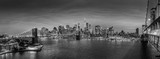 Fototapeta Nowy York - Brooklyn, Brooklyn park, Brooklyn Bridge, Janes Carousel and Lower Manhattan skyline at night seen from Manhattan bridge, New York city, USA. Black and white wide angle panoramic image.
