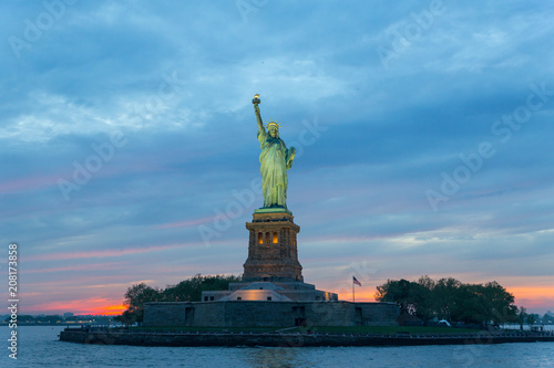 Poster New York City Statue of Liberty at dusk, New York City, USA.