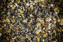 Small Rocks In The Beach