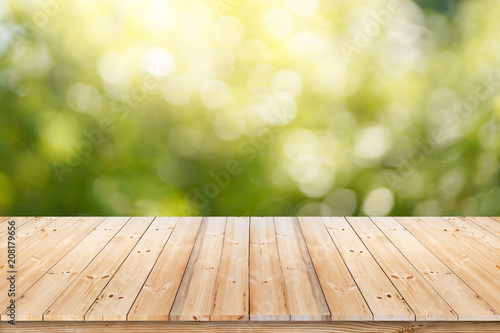 Fotografia  Abstract spring or summer with sunlight background and wood table