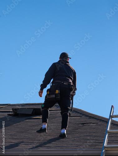 Fotografie, Obraz  Worker inspecting a damaged roof