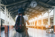 Young Woman Traveler Waiting For Friend At Train Station. Travel And Active Lifestyle Concept