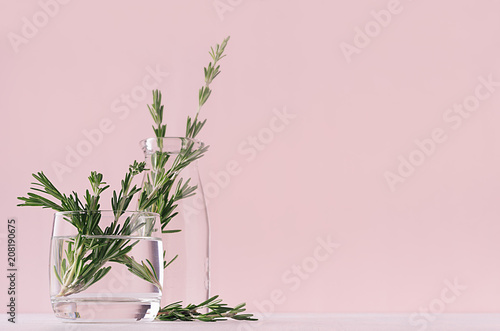 Gentle spring vanilla background of fresh bouquet rosemary in glass and retro milk bottle on white table and pink wall Fototapet