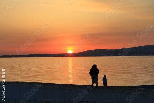 Spoed Foto op Canvas Zee zonsondergang Sunset on the sea shore.