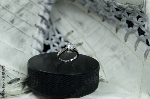 Photo  Engagement Ring on hockey puck with the inscription `Czech Republic` on the SILVER background