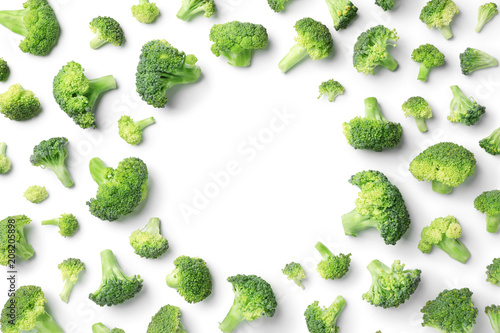 Flat lay composition with fresh green broccoli on light background