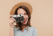 Portrait Of A Happy Young Girl Taking A Picture