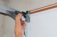 Repairman Repair Garage Door O...