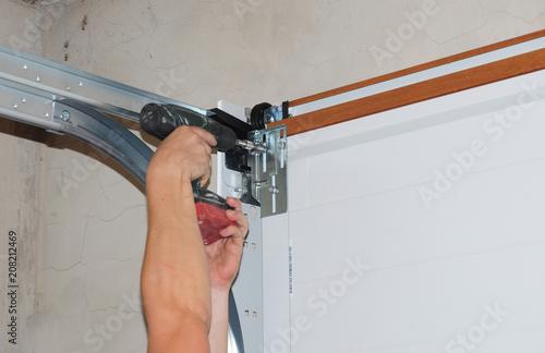 Repairman repair garage door opener Wallpaper Mural