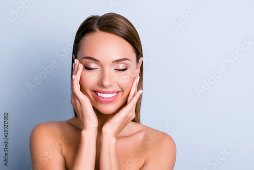 Fototapety, obrazy: Portrait of pleased satisfied girl touching face enjoying ideal perfect skin after procedure mask keeping eyes closed isolated on grey background