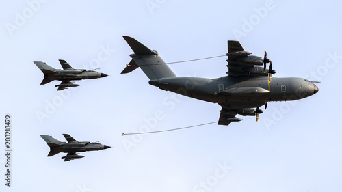 Photo Military tanker aircraft aerial refuelling two air force fighter bomber jets