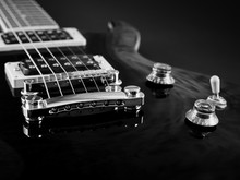 Electric Guitar Elements, Strings, Pickup Closeup Black And White View On Black Background