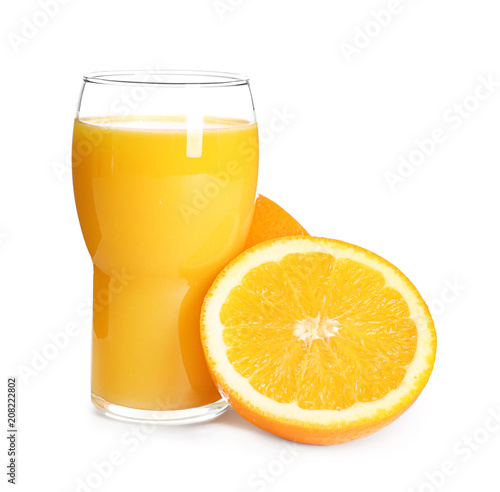 Glass with delicious citrus juice and fresh fruit on white background