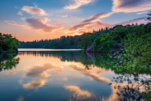 Sunset At Bolam Lake Country Park / Bolam Lake Country Park Is Located In The Beautiful Northumberland Countryside, It Is Surrounded By Woodland Seen Here In Early Summer