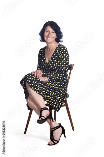 full portrait of a sitting woman on white