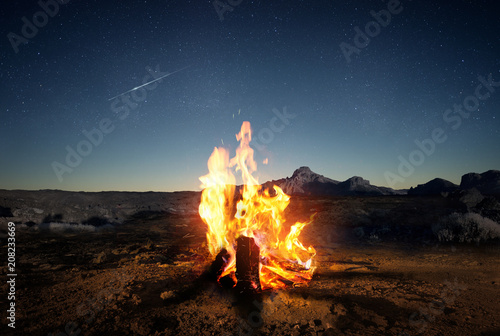 Aluminium Prints Camping Exploring the wilderness in summer. A glowing camp fire at dusk providing comfort and light to appreciate nature, good times and the night sky full of stars. Photo composite.