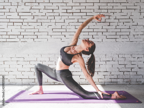 Tuinposter School de yoga Portrait of attractive woman doing exercises. Brunette with fit body on yoga mat. Healthy lifestyle and sports concept. Series of exercise poses.