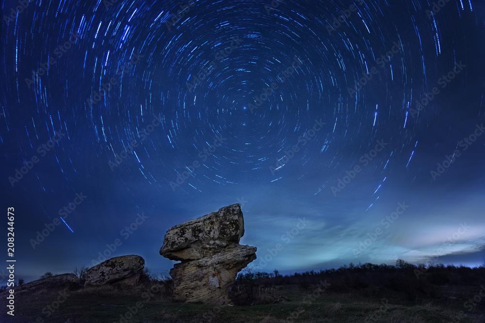 Fotografie, Obraz Star Trail with long exposure effect  at Dobrovanski gabi, Bulgaria