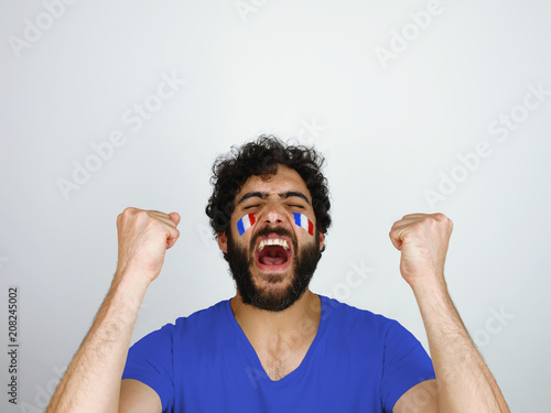 Sport fan screaming celebrating the triumph of his team Canvas Print